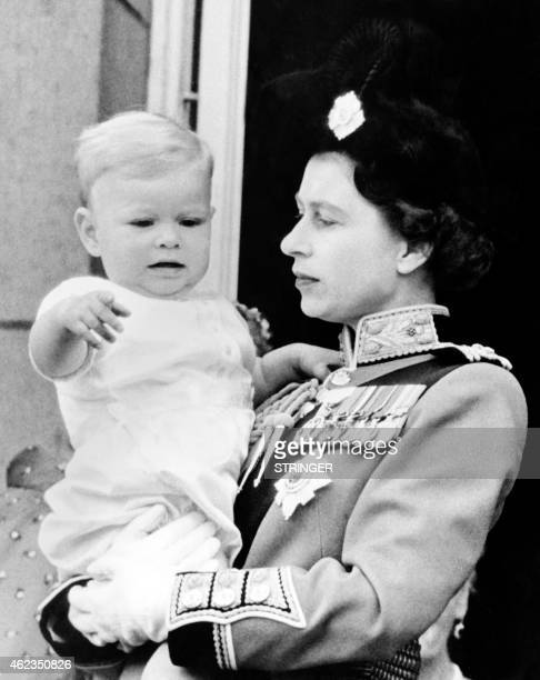 Britain's Queen Elizabeth II and Prince Andrew Duke of York appear on June 12 1961 on the balcony of Buckingham Palace following the Trooping the...