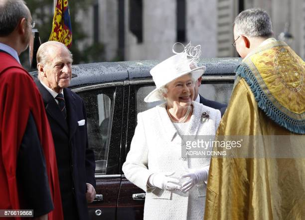 Britain's Queen Elizabeth II and Prince Philip arrive at Westminster Abbey in central London 19 November 2007 Royal family and friends gathered in...