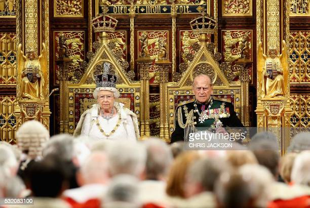 TOPSHOT Britain's Queen Elizabeth II and Prince Philip Duke of Edinburgh are pictured ahead of the Queen's Speech during the State Opening of...