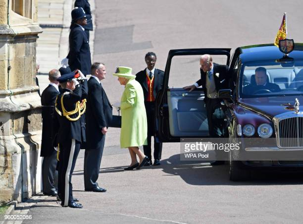 Britain's Queen Elizabeth II and Prince Philip, Duke of Edinburgh arrives at St George's Chapel at Windsor Castle before the wedding of Prince Harry...