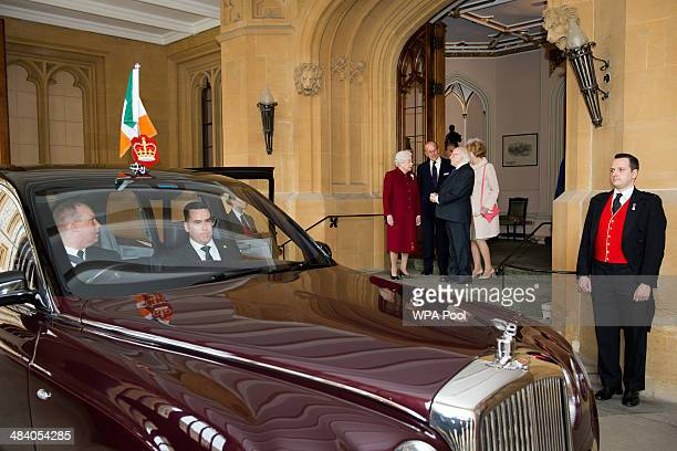 Britain's Queen Elizabeth II and Prince Philip Duke of Edinburgh bid farewell to Irish President Michael D Higgins and his wife Sabina at the end of...