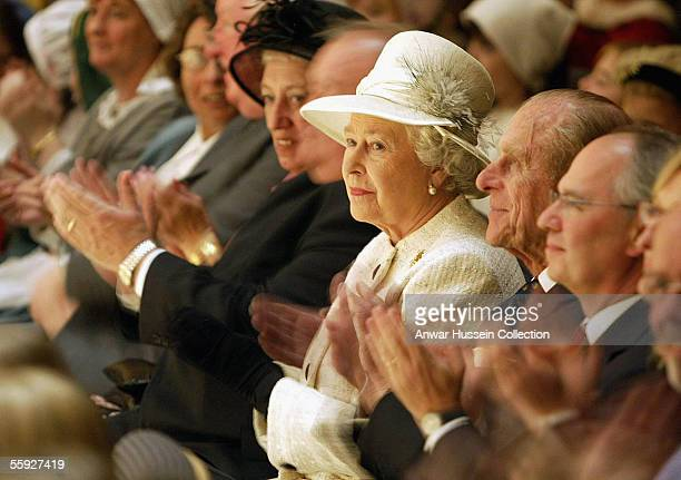 Britain's Queen Elizabeth II and Prince Philip, Duke of Edinburgh enjoy a performance at the Sage Music centre on October 14, 2005 during their visit...