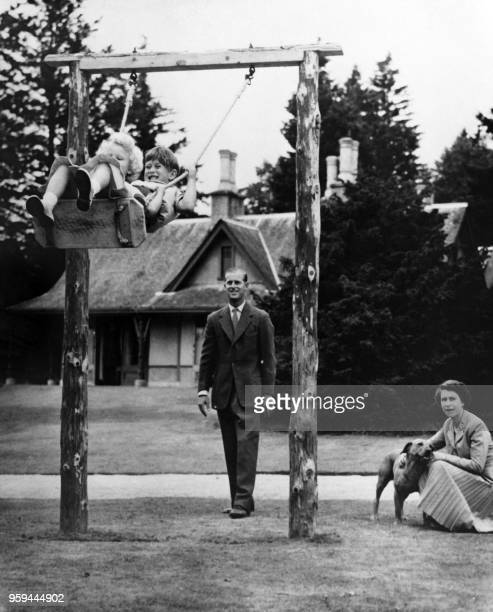 Britain's Queen Elizabeth II and Prince Philip, Duke of Edinburgh play with Prince Charles and Princess Anne at Balmoral Castle in Aberdeenshire in...