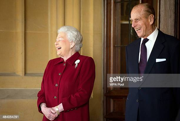 Britain's Queen Elizabeth II and Prince Philip, Duke of Edinburgh react as they bid farewell to Irish President Michael D. Higgins and his wife...