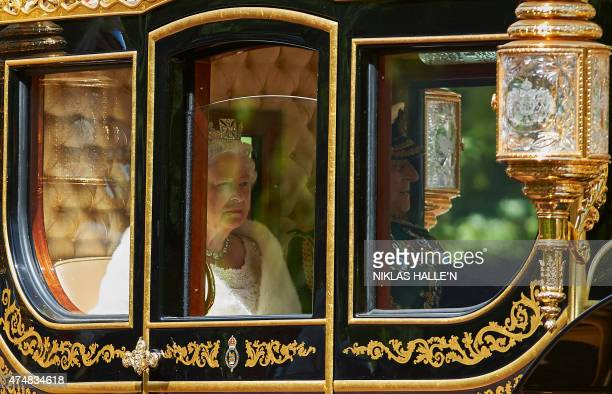 Britain's Queen Elizabeth II and Prince Philip Duke of Edinburgh ride in the Diamond Jubilee State Coach from Buckingham Palace to the Palace of...