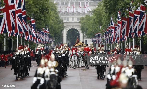 Britain's Queen Elizabeth II and Prince Philip Duke of Edinburgh ride in the Diamond Jubilee state carriage escorted by members of the Household...