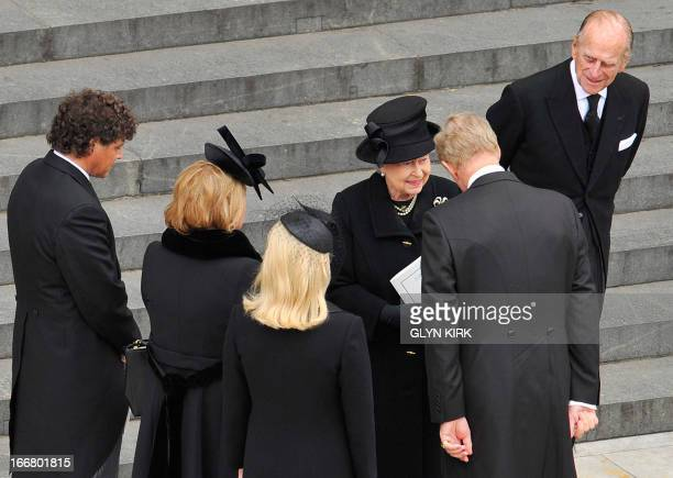 Britain's Queen Elizabeth II and Prince Philip, Duke of Edinburgh speak with Marco Grass, Carol Thatcher, Sarah Thatcher and Mark Thatcher as they...