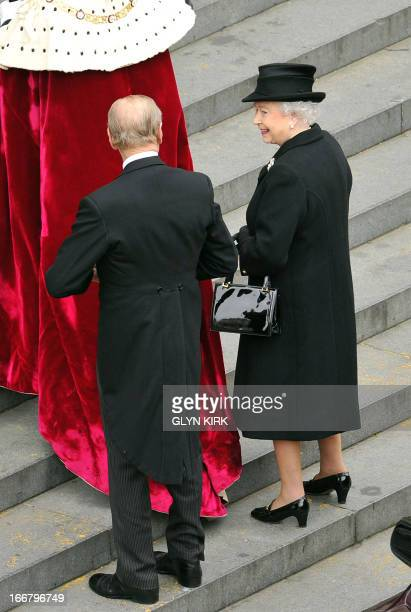 Britain's Queen Elizabeth II and Prince Philip, Duke of Edinburgh, arrive to attend the ceremonial funeral of British former prime minister Margaret...