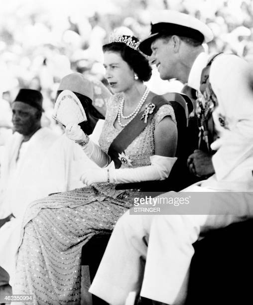 Britain's Queen Elizabeth II and Prince Philip Duke of Edinburgh watch on December 4 1961 the Susu dancers as they visit the Northern Province of...