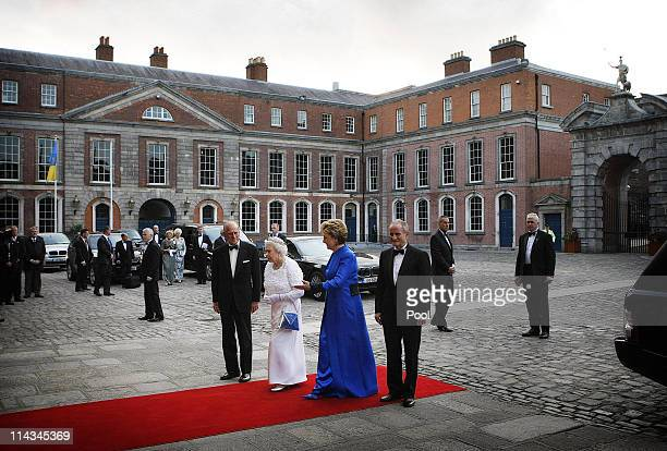 Britain's Queen Elizabeth II and Prince Philip, Duke of Edinburgh arrive with Irish President Mary McAleese and her husband Dr. Martin McAleese for a...