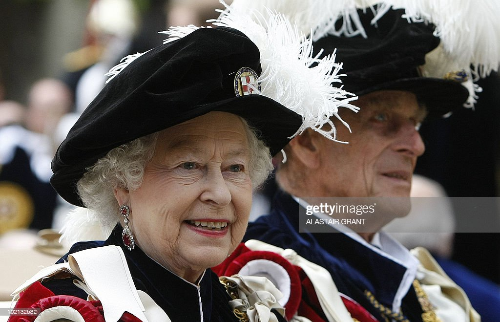 Britain's Queen Elizabeth II and Prince Philip leave after The Order of the Garter Service, at St George's Chapel in Windsor Castle, Windsor, southern England on June 14, 2010. The Order of the Garter is the most senior and the oldest British Order of Chivalry and was founded by Edward III in 1348. The patron saint of the Order is St George (patron saint of soldiers and also of England) and the spiritual home of the Order is St George's Chapel, Windsor. Every knight is required to display a banner of his arms in the Chapel, together with a helmet, crest and sword and an enamelled stallplate. These 'achievements' are taken down on the knight's death and the insignia are returned to the Sovereign. The stallplates remain as a memorial and these now form one of the finest collections of heraldry in the world. AFP PHOTO / Alastair Grant/ POOL