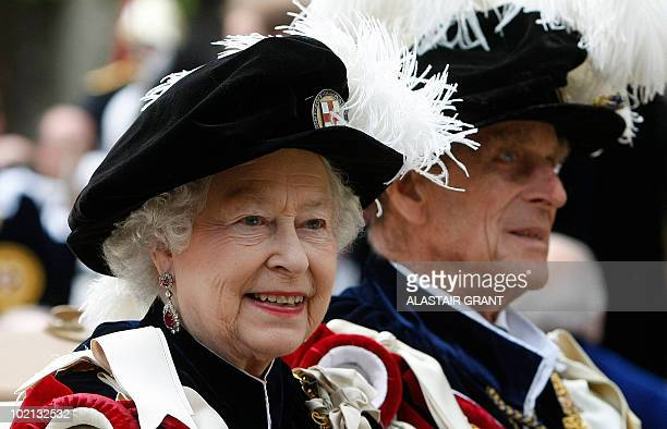 Britain's Queen Elizabeth II and Prince Philip leave after The Order of the Garter Service, at St George's Chapel in Windsor Castle, Windsor,...