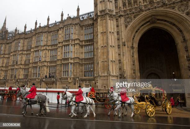 Britain's Queen Elizabeth II and Prince Philip leave the Houses of Parliament in the Jubilee State Coach in London on May 18 after attending the...