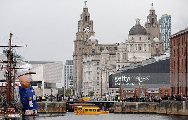 Britain's Queen Elizabeth II and Prince Philip ride on a Yellow Duckmarine boat in Albert Dock in Liverpool northwest England on May 17 2012The...