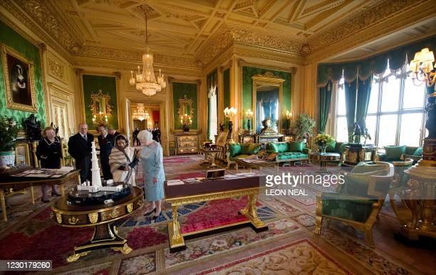 Britain's Queen Elizabeth II and Prince Philip, the Duke of Edinburgh show India's President Pratibha Patil and her husband Dr Devisingh Ramsingh...