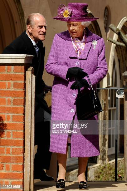 Britain's Queen Elizabeth II and Prince Philip, the Duke of Edinburgh leave after attending an Easter Sunday church service in Windsor on April 4,...