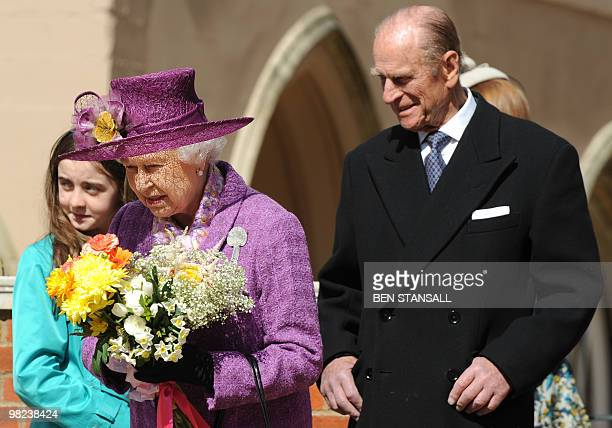Britain's Queen Elizabeth II and Prince Philip the Duke of Edinburgh leave after attending an Easter Sunday church service in Windsor on April 4 2019...