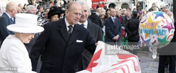 Britain's Queen Elizabeth II and Prince Philip unveil the Jubilee Walkway panel on Parliament Square in central London, 19 November 2007. Queen...