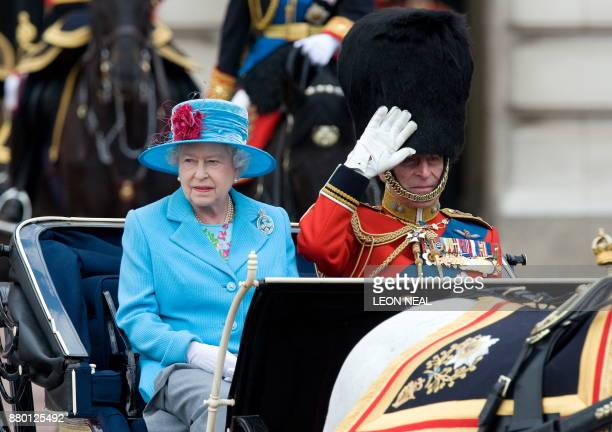 Britain's Queen Elizabeth II and Prince Phillip Duke of Edinburgh leave Buckingham Palace ahead of The Queen's Birthday Parade 'Trooping the Colour'...