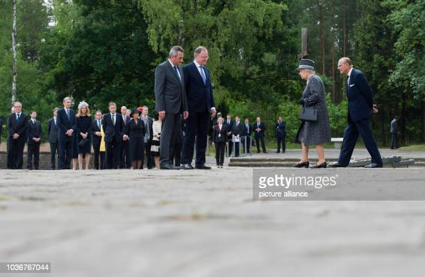 Britain's Queen Elizabeth II and Prince Phillip with the director of the memorial JensChristian Wagner and Minister President of Lower Saxony Stephan...