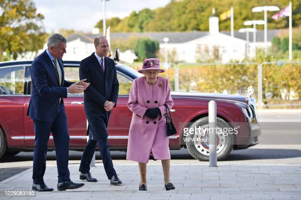 Britain's Queen Elizabeth II and Prince William, Duke of Cambridge, speak with Dstl Chief Executive Gary Aitkenhead as they head back to the...