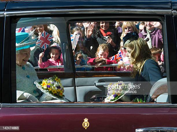 Britain's Queen Elizabeth II and Princess Beatrice of York leave the Royal Maundy Service at York Minster in York northern England April 5 2012...