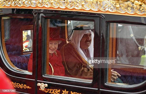 Britain�s Queen Elizabeth II and Qatar's emir Sheikh Hamad bin Khalifa alThani travel by horsedrawn carriage as they process from the Royal Dias to...