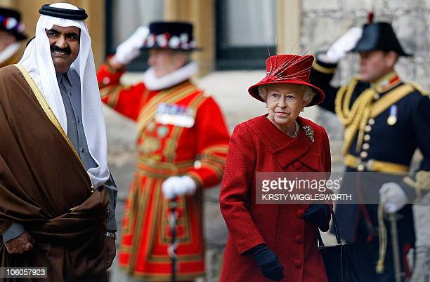 Britain's Queen Elizabeth II and Qatar's emir Sheikh Hamad bin Khalifa alThani are saluted during a Ceremonial Welcome at Windsor Castle in Windsor...