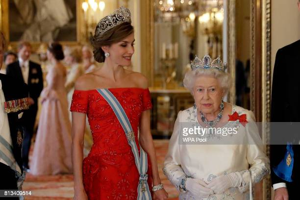 Britain's Queen Elizabeth II and Queen Letizia of Spain pose for a group photograph before a State Banquet at Buckingham Palace on July 12 2017 in...