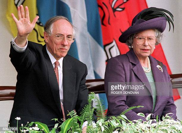 Britain's Queen Elizabeth II and Scottish First Minister Donald Dewar watch the parades from the Royal Dias after the opening of the Scottish...