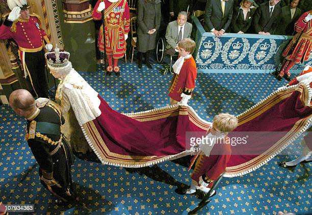 Britain's Queen Elizabeth II and the Duke of Edinburgh Prince Philip walk to the House of Lords during the State Opening of Parliament 23 November...