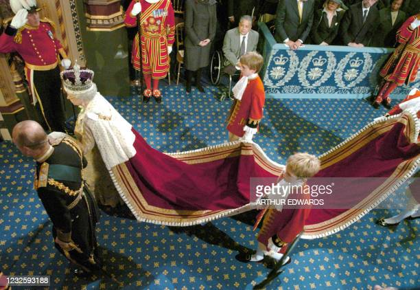 Britain's Queen Elizabeth II and the Duke of Edinburgh, Prince Philip walk to the House of Lords during the State Opening of Parliament 23 November...