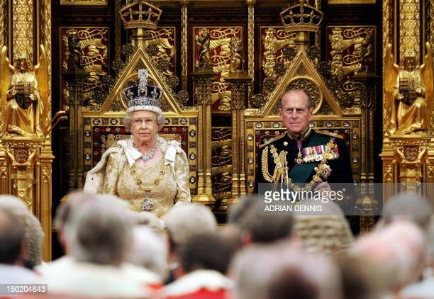 Britain's Queen Elizabeth II and the Duke of Edinburgh Prince Philip sit before The House of Lords prior to giving the Queen's Speech during The...