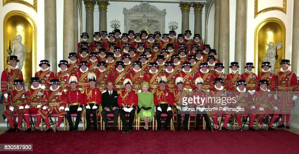 Britain's Queen Elizabeth II and the Duke of Edinburgh sit with the Yeomen of the Guard probably the oldest military corps still active in the world...