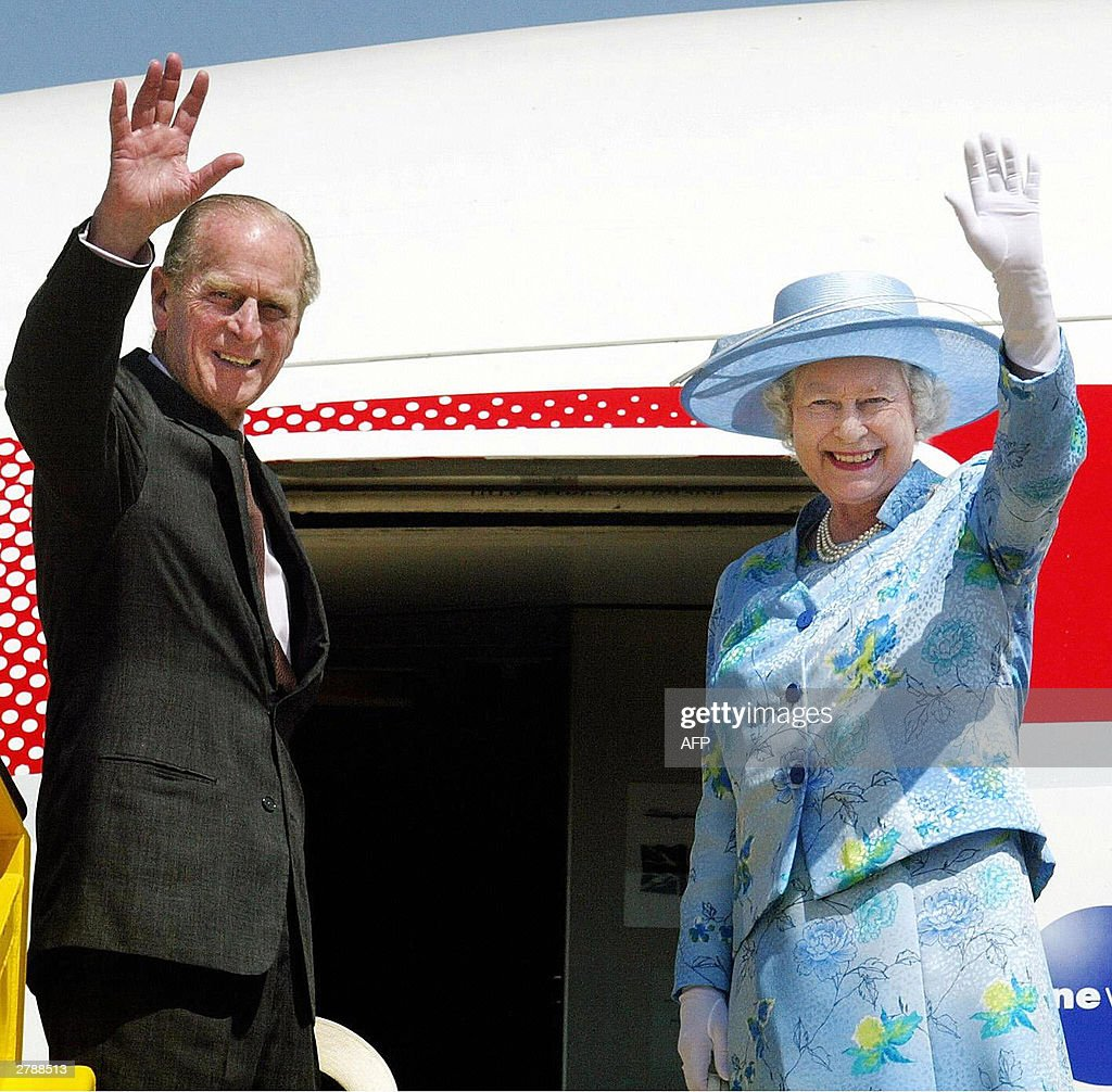 Britain's Queen Elizabeth II and The Duke of Edinburgh wave goodbye as they board their plane at Abuja airport, Nigeria, 06 December 2003. The Queen yesterday addressed the Commonwealth Summit. AFP PHOTO/Pool