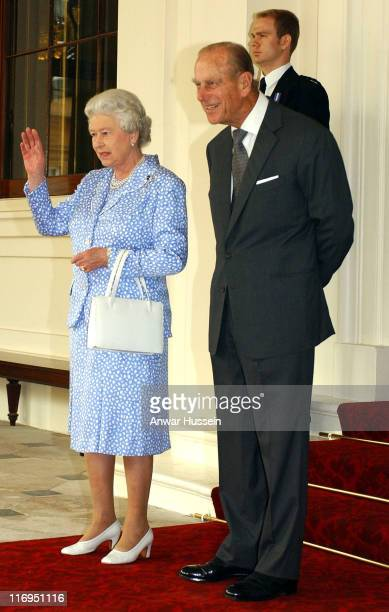 Britain's Queen Elizabeth II and the Duke of Edinburgh wave goodbye to President Putin and Mrs Putin as they leave Buckingham Palace at the end of...