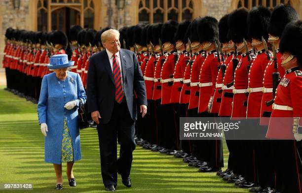Britain's Queen Elizabeth II and US President Donald Trump inspect the guard of honour formed of the Coldstream Guards during a welcome ceremony at...