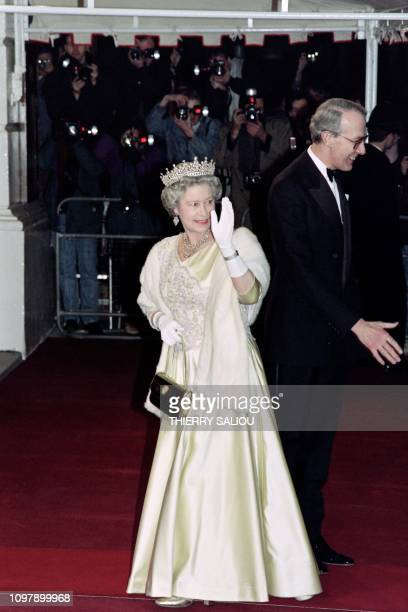 Britain's Queen Elizabeth II arrives at a performance of Mozart's Don Giovanni at the Royal Opera House on the occasion of the 40th anniversary of...