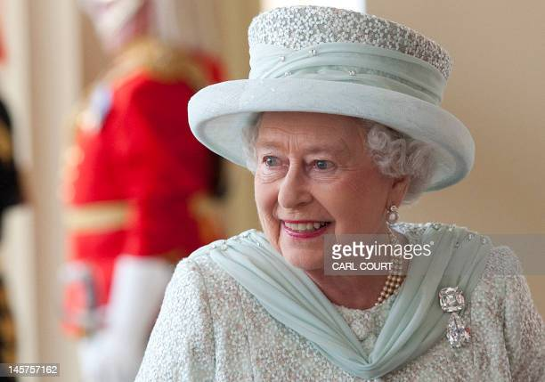 Britain's Queen Elizabeth II arrives at Buckingham Palace at the end of a carriage procession following a national service of thanksgiving in honour...
