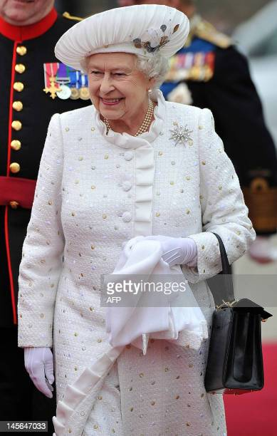 Britain's Queen Elizabeth II arrives at Chelsea harbour to embark to join the Thames Diamond Jubilee Pageant on the River Thames in London on June 3...