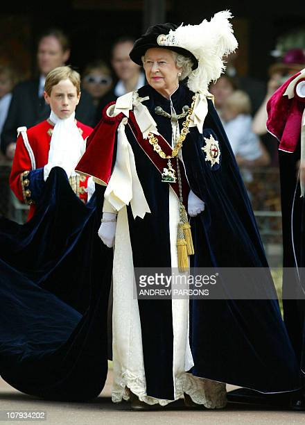 Britain's Queen Elizabeth II arrives at St Georges Chapel Windsor 13 June 2005 before the Service for The Order of the Garter Former Conservative...