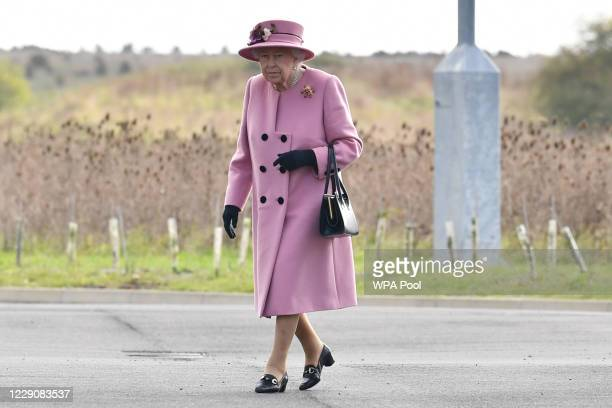 Britain's Queen Elizabeth II arrives at the Energetics Analysis Centre as they visit the Defence Science and Technology Laboratory at Porton Down...