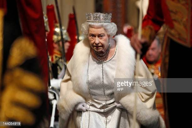 Britain's Queen Elizabeth II arrives at the Norman Porch in the Palace of Westminster home to the Houses of Parliament in London on May 9 2012 during...