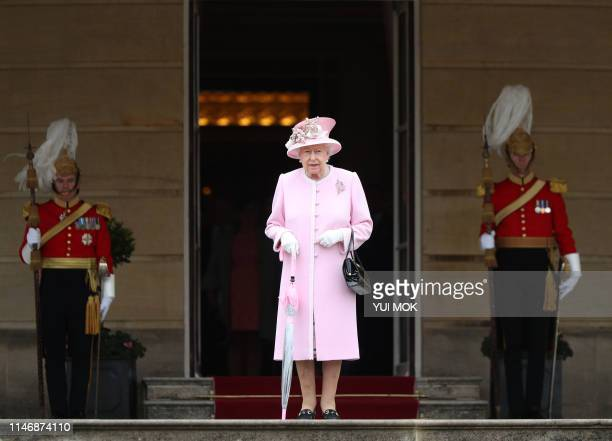 Britain's Queen Elizabeth II arrives at the Queen's Garden Party in Buckingham Palace central London on May 29 2019