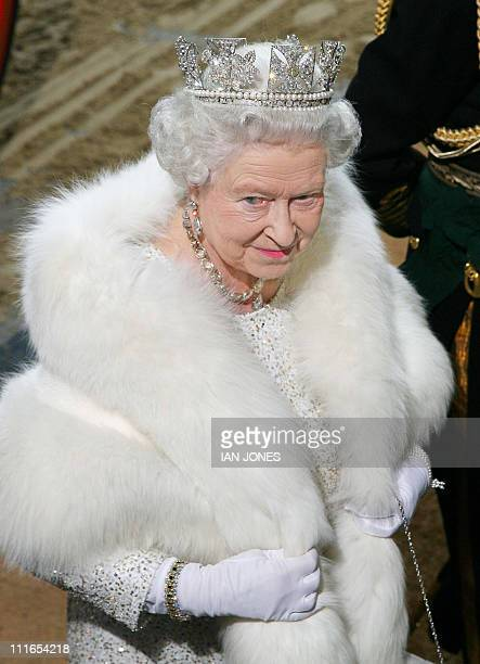 Britain's Queen Elizabeth II arrives at the Sovereigns Entrance of the Palace of Westminster for the State Opening of Parliament in London 15...