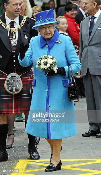 Britain's Queen Elizabeth II arrives at Waverley Station in Edinburgh Scotland on September 9 2015 Westminster Abbey's bells will peal a flotilla...