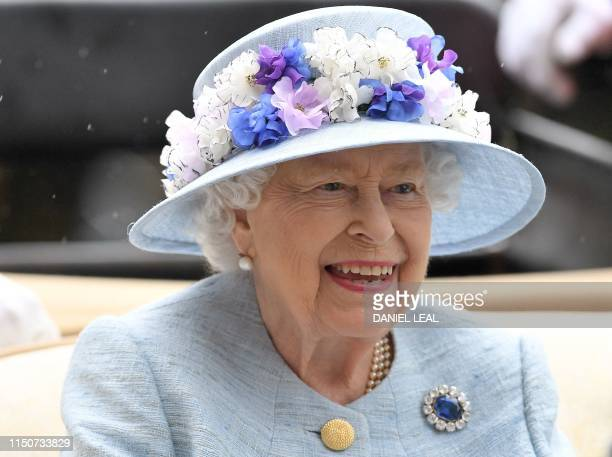 Britain's Queen Elizabeth II arrives by carriage on day two of the Royal Ascot horse racing meet, in Ascot, west of London, on June 19, 2019. - The...