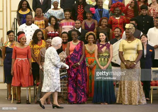 Britain's Queen Elizabeth II arrives for a group photo during the Queen's Young Leaders Awards ceremony at Buckingham Palace in London on June 29...