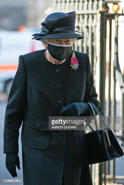 Britain's Queen Elizabeth II arrives for a service to mark the centenary of the burial of the Unknown Warrior ahead of Remembrance Sunday at...