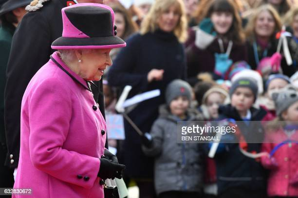 CORRECTION Britain's Queen Elizabeth II arrives for a visit to the Sainsbury Centre for Visual Arts at the University of East Anglia in Norwich east...